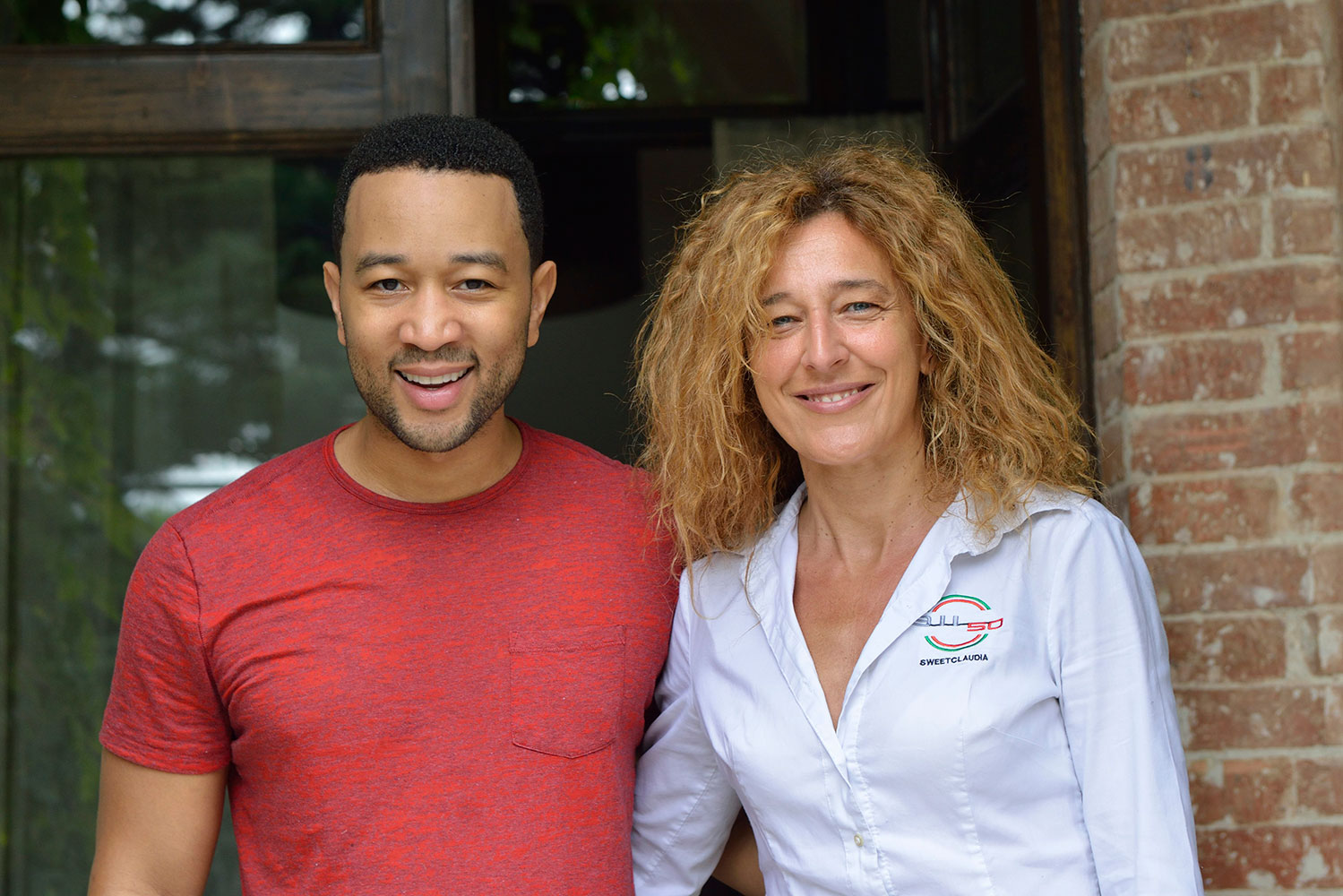 Claudia with John Legend