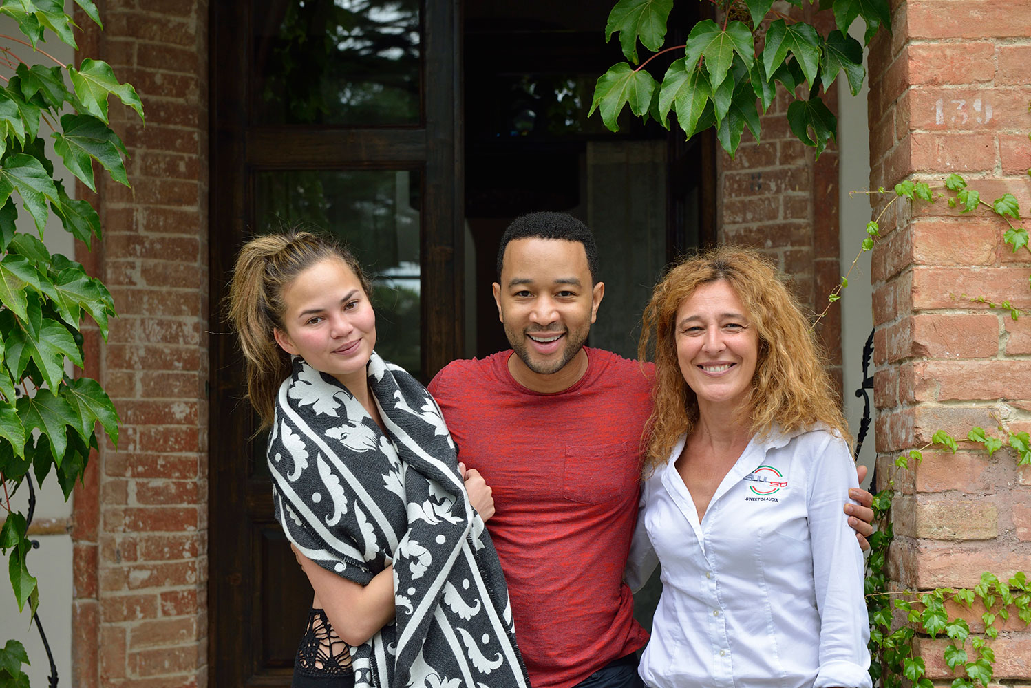 Claudia with John Legend and Christine Teigen